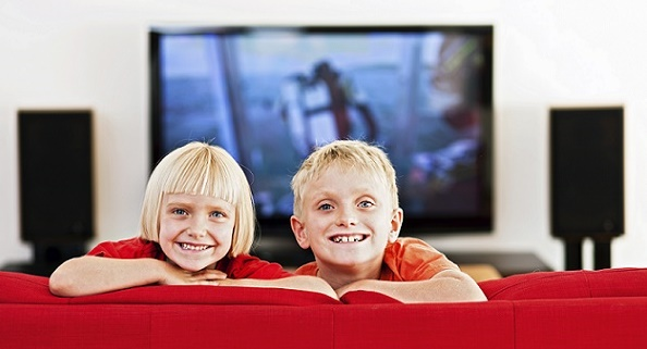 stock-photo-20509372-portrait-of-smiling-blond-brother-and-sister-on-red-couch
